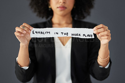 Buy stock photo Studio shot of an unrecognizable businesswoman holding a piece of paper written