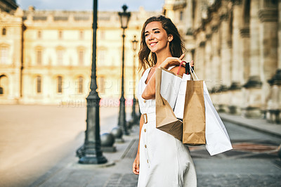 Buy stock photo Shot of a beautiful young woman out on a shopping spree in the city of Paris