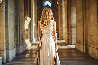 Buy stock photo Rearview shot of a beautiful young woman out on a shopping spree in the city of Paris