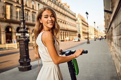 Buy stock photo Portrait of a beautiful young woman riding a scooter in the city of Paris