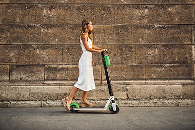 Buy stock photo Shot of a beautiful young woman riding a scooter in the city of Paris