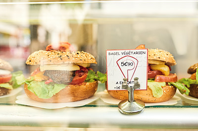 Buy stock photo Shot of delicious bagel sandwiches for sale inside a bakery shop in Paris, France