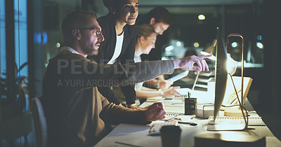 Buy stock photo Cropped shot of a diverse group of businesspeople working on technology in the office late at night