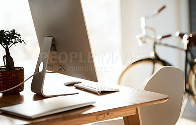 Buy stock photo Still life shot of a computer on a table inside a modern office
