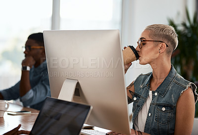 Buy stock photo Shot of an attractive young businesswoman drinking coffee while working inside an office