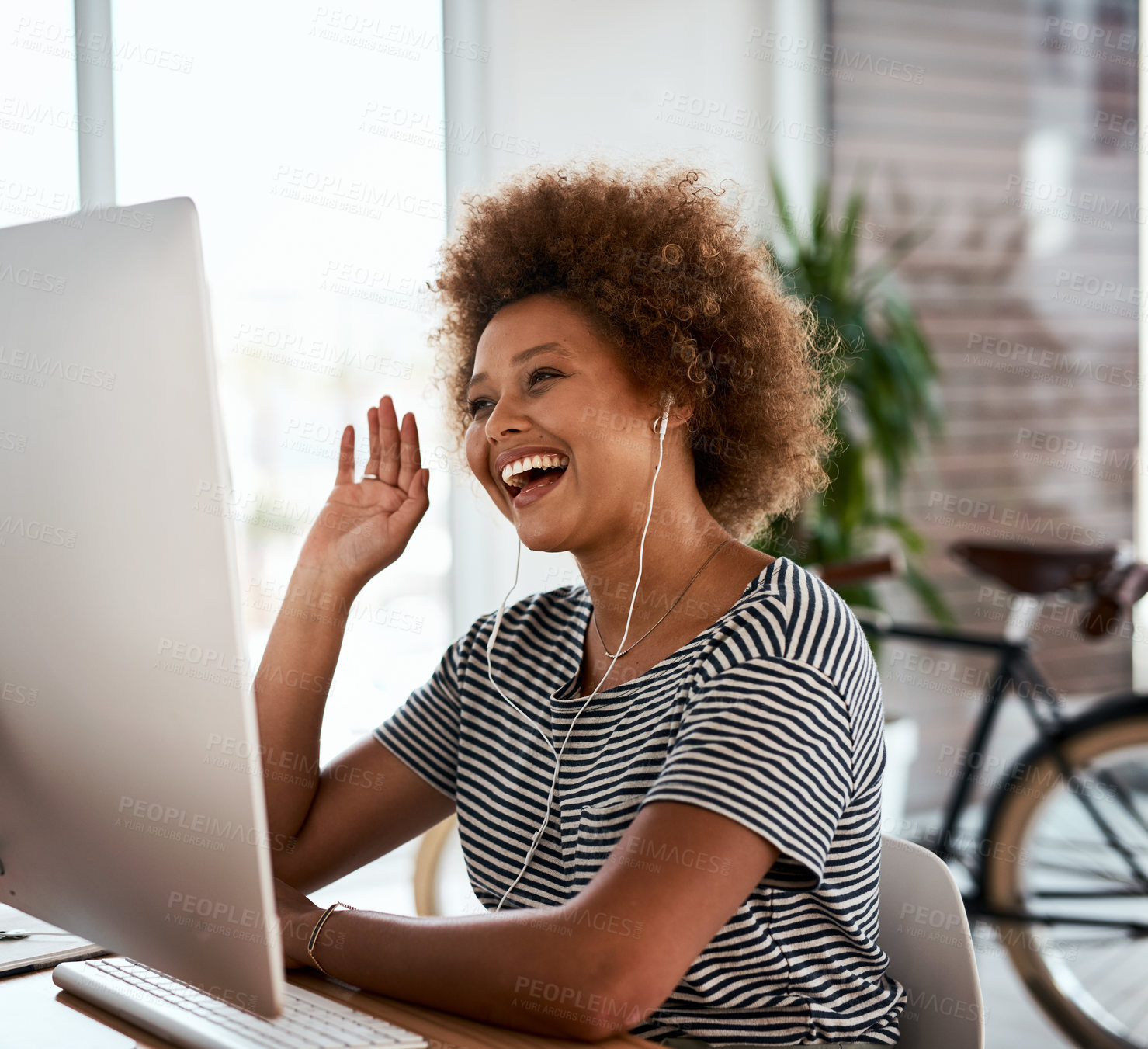 Buy stock photo Shot of an attractive young businesswoman making a video call on a computer inside her office