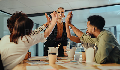 Buy stock photo Shot of a group of businesspeople giving each other a high five in an office at night