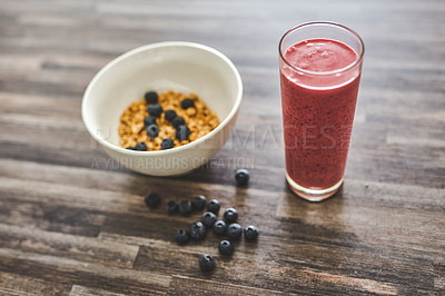 Buy stock photo Shot of a a bowl of oats of a smoothie on a wooden background