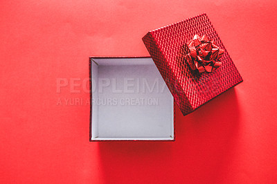 Buy stock photo Shot of a gift box against a red background
