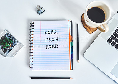 """Buy stock photo Shot of a notebook with """"work from home"""" written on it at a work desk"""