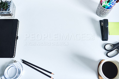 Buy stock photo High angle shot of various business tools on a work desk