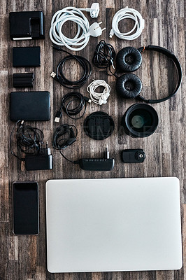 Buy stock photo Shot of various cables and wireless devices on a desk