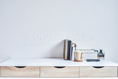 Buy stock photo Shot of a tidy work space  with various business tools on it