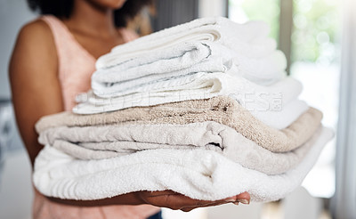 Buy stock photo Cropped shot of an unrecognizable woman carrying clean towels art home