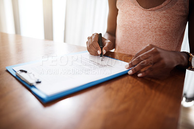 Buy stock photo Cropped shot of an unrecognizable woman signing a form
