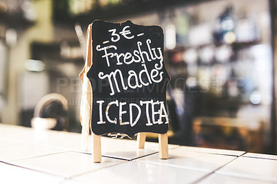 Buy stock photo Closeup shot of a sign advertising freshly made iced tea in a cafe