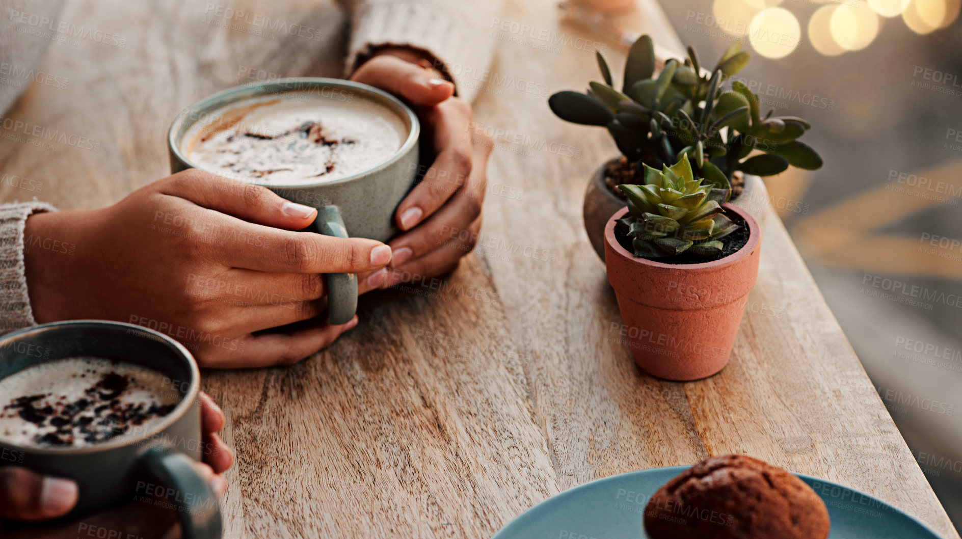 Buy stock photo Cropped shot of an unrecognizable woman having coffee with her female friend at a coffee shop