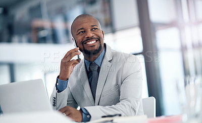 Buy stock photo Shot of a mature businessman using a smartphone and laptop in a modern office