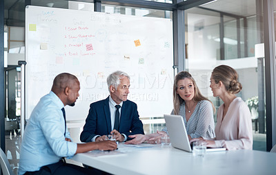 Buy stock photo Shot of a group of businesspeople having a boardroom meeting in a modern office