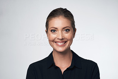 Buy stock photo Portrait of a young businesswoman against a grey background