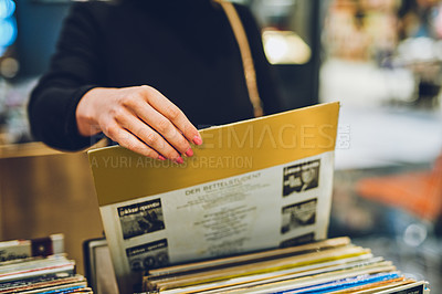 Buy stock photo Shot of a young woman shopping for vinyl records at a store