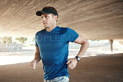 Buy stock photo Shot of a man out for a run during the day