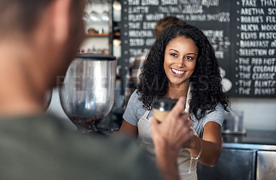Buy stock photo Cropped shot of a female barista serving a customer in a cafe