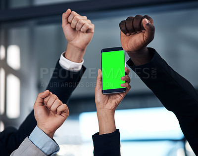 Buy stock photo Cropped shot of a group of businesspeople cheering and holding a smartphone in a modern office