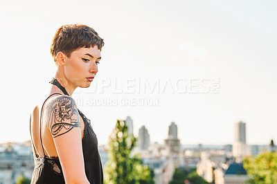 Buy stock photo Cropped shot of an attractive young woman looking thoughtful while sightseeing in a foreign city during the day