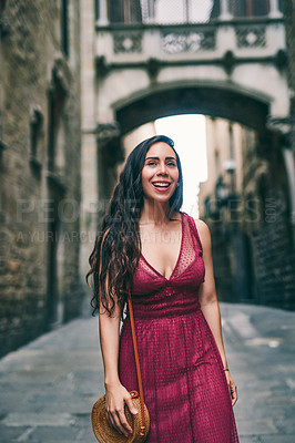 Buy stock photo Cropped shot of an attractive young woman standing alone while touring the streets of Barcelona in Spain
