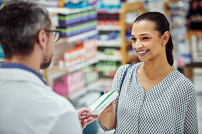 Buy stock photo Cropped shot of a pharmacist assisting a customer in a chemist