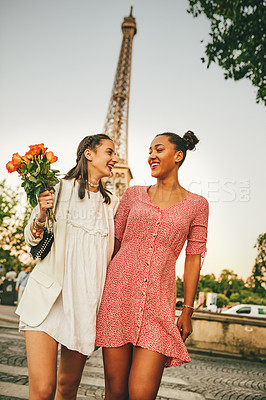 Buy stock photo Shot of two attractive young women walking together outdoors in Paris, France