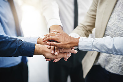Buy stock photo Cropped shot of an unrecognizable group of businesspeople standing in the office together with their hands stacked