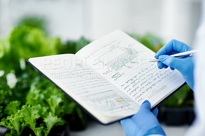 Buy stock photo Cropped shot of an unrecognizable scientist making notes