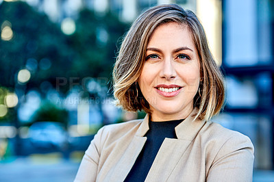 Buy stock photo Portrait of an attractive young businesswoman feeling confident and cheerful in the city
