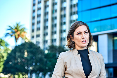 Buy stock photo Shot of an attractive and confident young businesswoman in the city