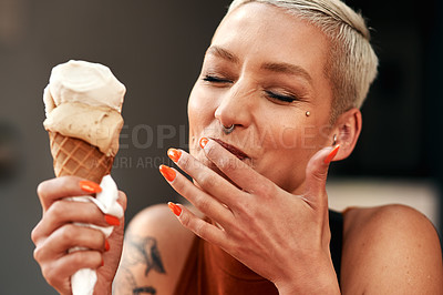 Buy stock photo Cropped shot of a young woman enjoying a ice cream cone outdoors
