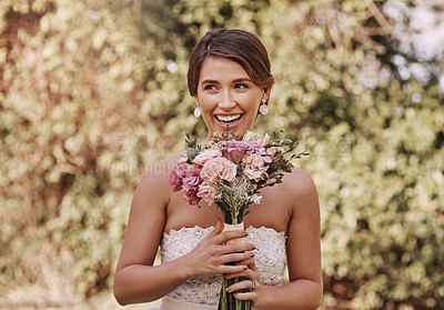 Buy stock photo Cropped shot of a beautiful young bride smiling while standing with a bouquet in her hands on her wedding day