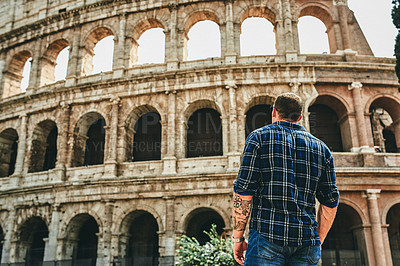 Buy stock photo Cropped shot of an unrecognizable man standing alone near the famous Colosseum during a day out in Rome