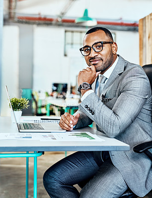 Buy stock photo Cropped portrait of a handsome young businessman sitting in his office and looking contemplative with his hand on his chin