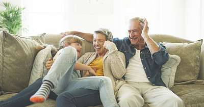 Buy stock photo Shot of two grandparents spending quality time with their granddaughter
