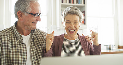 Buy stock photo Cropped shot of a senior couple cheering while using a laptop at home