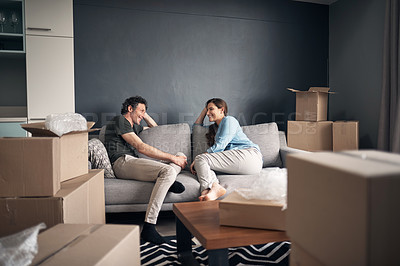 Buy stock photo Shot of a couple taking a break while moving house