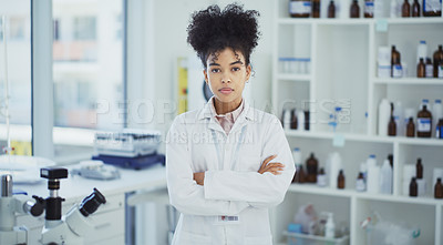Buy stock photo Cropped portrait of an attractive young female scientist standing with her arms crossed in a laboratory