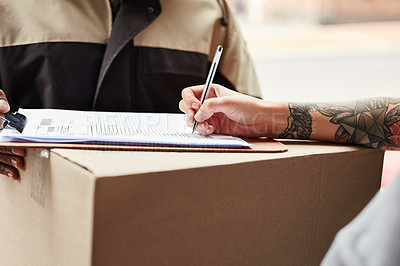 Buy stock photo Cropped shot of an unrecognizable woman signing for her delivery from a male courier at her home