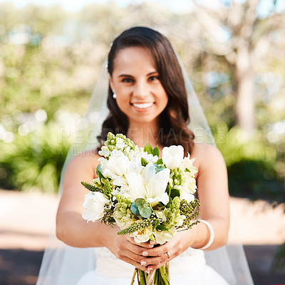 Buy stock photo Cropped portrait of a beautiful young bride smiling while holding a bouquet of flowers on her wedding day