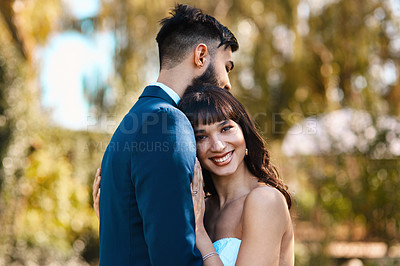 Buy stock photo Cropped shot of an affectionate young bride smiling while leaning on her groom's chest on their wedding day