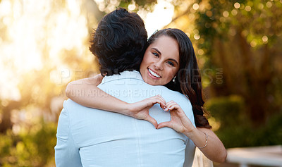 Buy stock photo Cropped shot of a young couple on their wedding day