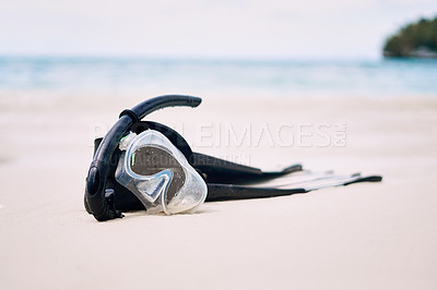 Buy stock photo Still life shot of snorkeling gear on a beach in Raja Ampat, Indonesia