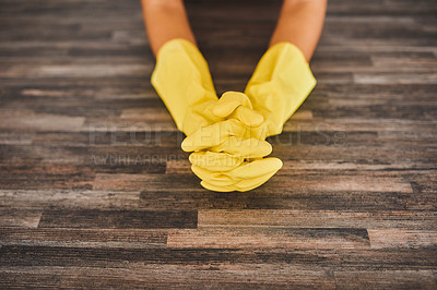 Buy stock photo Cropped shot of a young woman wearing rubber gloves while cleaning her home